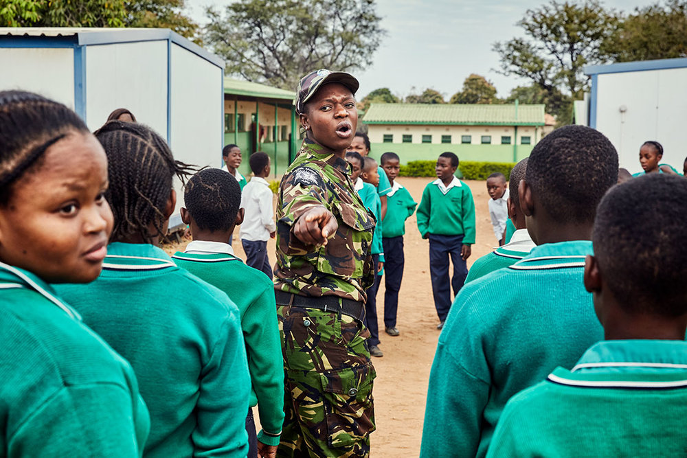 Black Mamba scout Nkateko Mzimba shows students how to properly stand at attention, Foskor Primary School, South Arica, 2017.