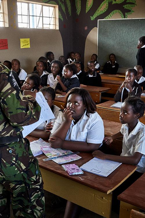 Black Mamba Nkateko Mzimba talks to children at Maseke Primary School, South Africa, 2017.