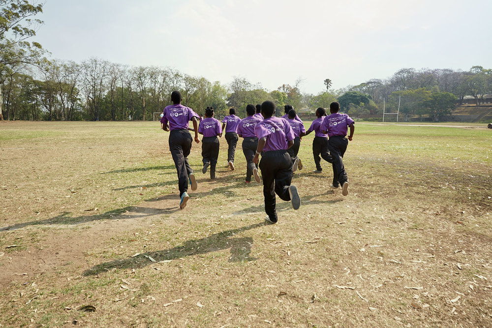 The girls run during a training session