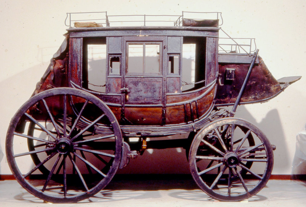 Before: stagecoach with layers of varnish