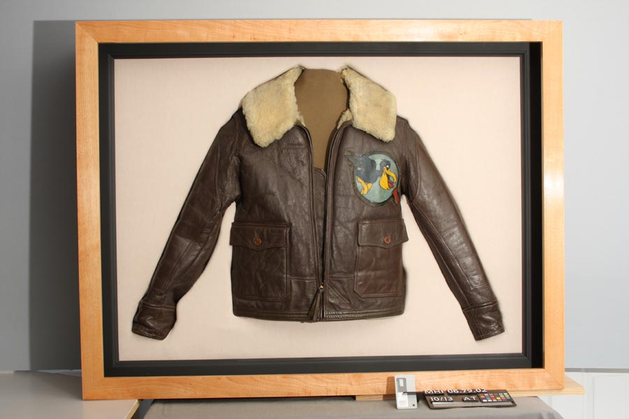 After: flight jacket after textile conservation treatment to sleeve