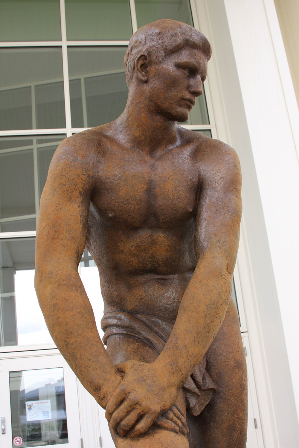 Before: bronze sculpture with patination damage