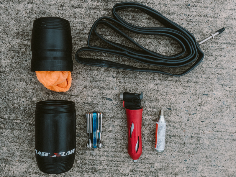 "XLAB Gear Pod:  ""I've never liked a dangling saddlebag, so instead I carry a water-bottle-style tool holder.""  $9.95"