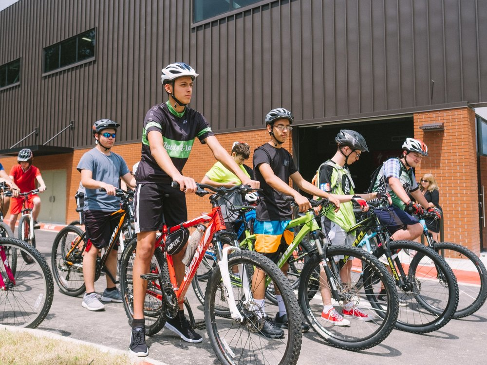 Students line up before cycling practice at the Arkansas Arts Academy in Rogers.