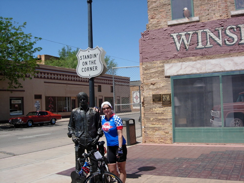 Peggy Muncy stands on a corner in Winslow, Arizona on a cross country ride in 2008.