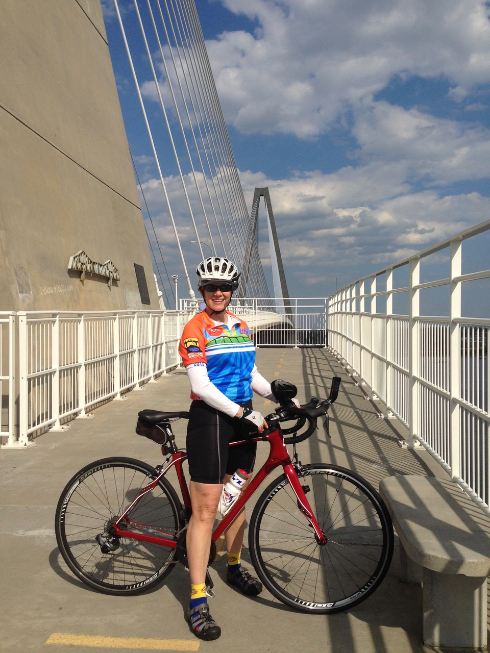 Peggy stands on Ravenel Bridge in Charleston, South Carolina, a cable-stayed bridge spanning 2.7 miles.