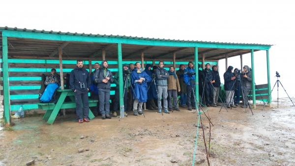 Counters and ecotourists sheltering from the rain. Photo by Eva Knižátková.