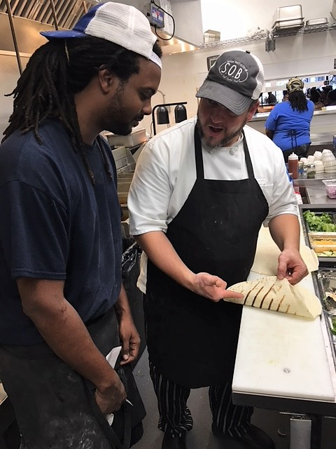 Josh (right), the Wilmington Kitchen Manager training the Statesboro Kitchen Manager, Ellis.