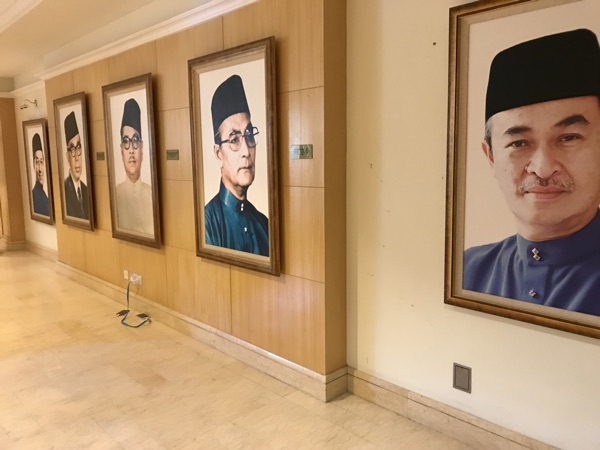 Portraits of former Malaysian PMs at the Perdana Leadership Foundation.