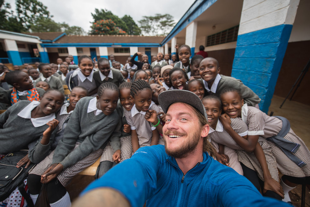Andrew Bydlon making new friends on a project with HEART Africa in Nairobi, Kenya