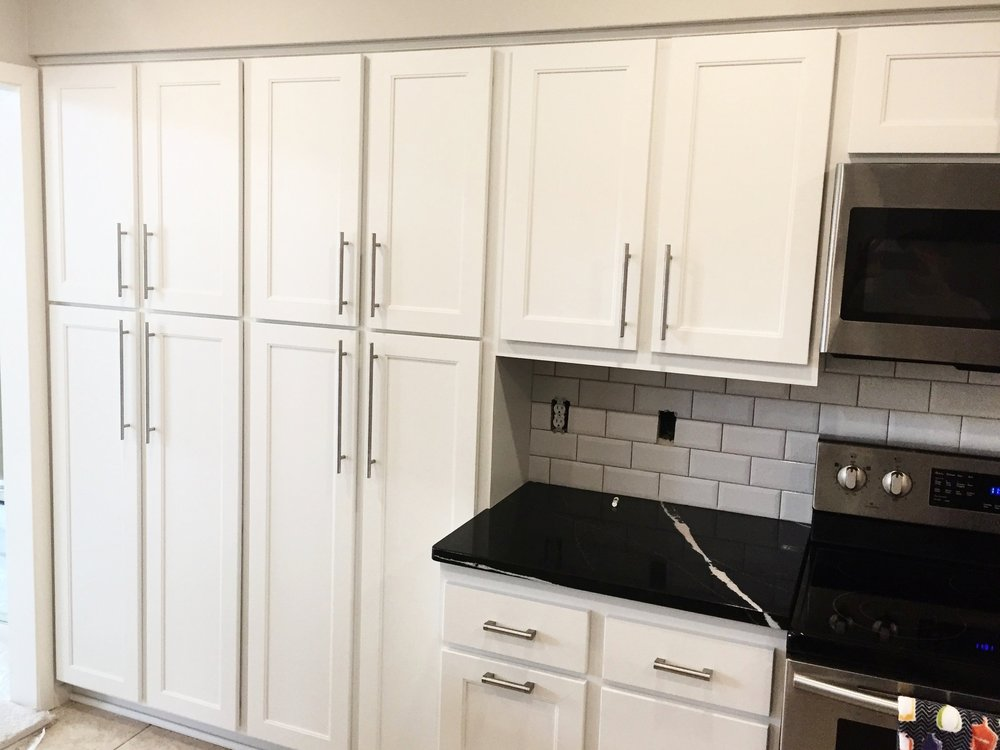 New cabinets to add to the refaced ones -