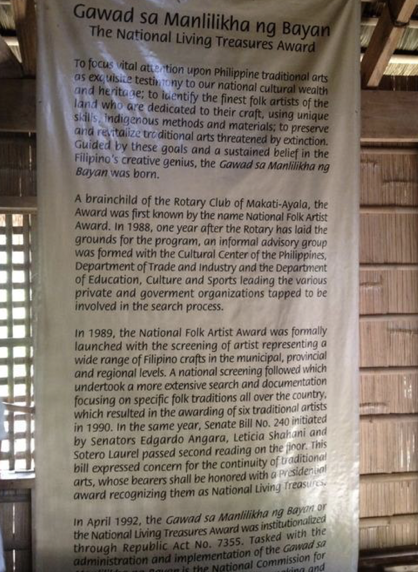 A white banner scroll in honor of Lang Dulay inside her house.