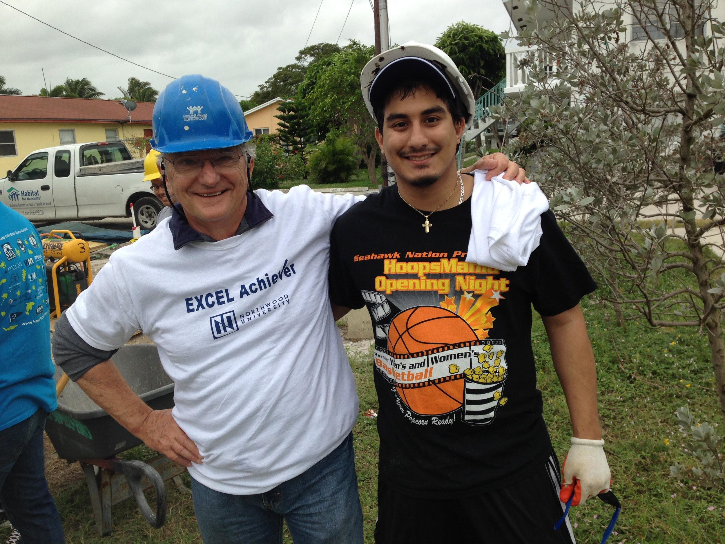 Dr. Ed Howell and Adalberto Trujillo assist Habitat for Humanity.