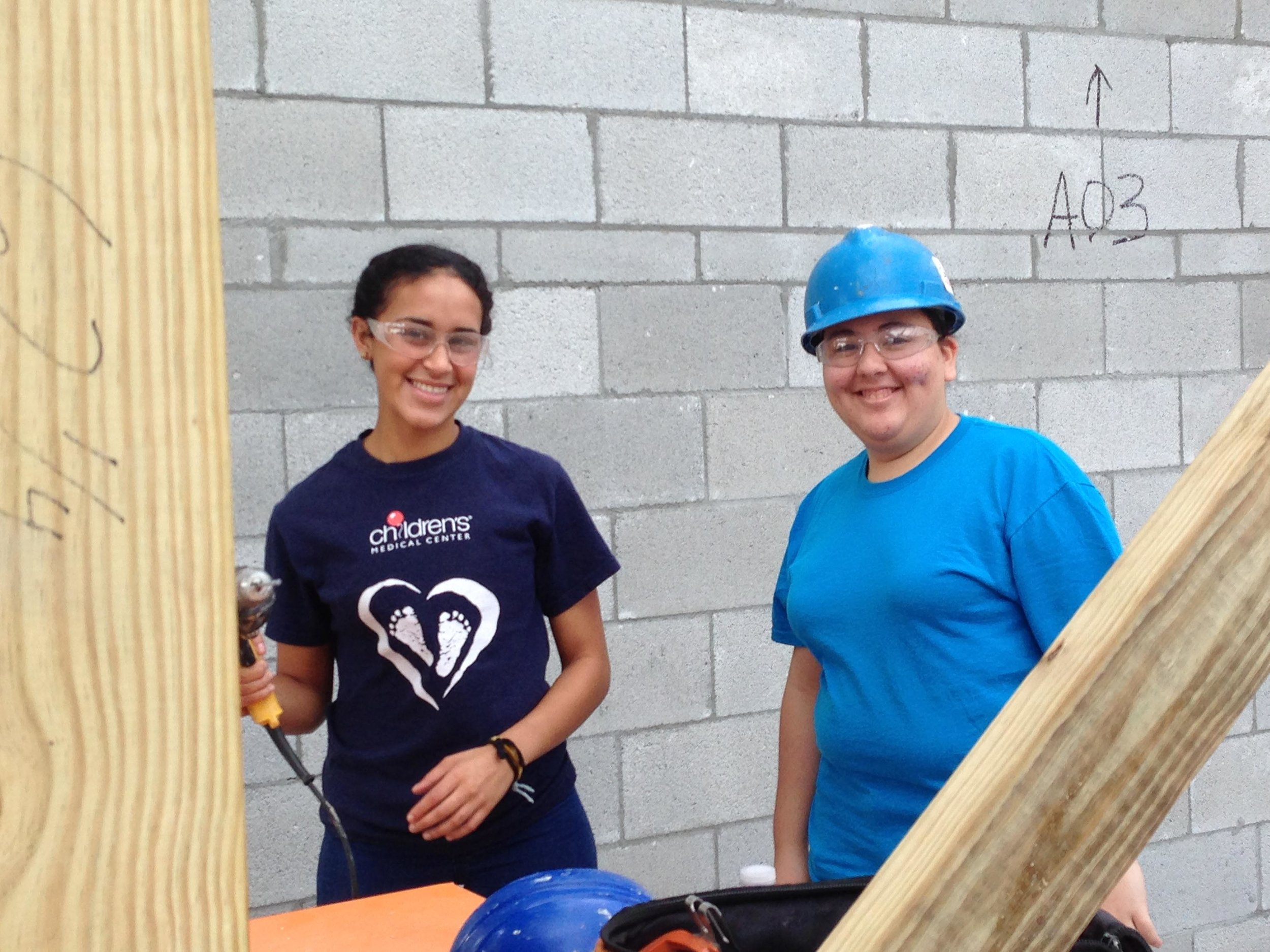 Northwood students Angelica Diaz-Martinez (left) and Melanie Gil volunteer at the Habitat for Humanity project.
