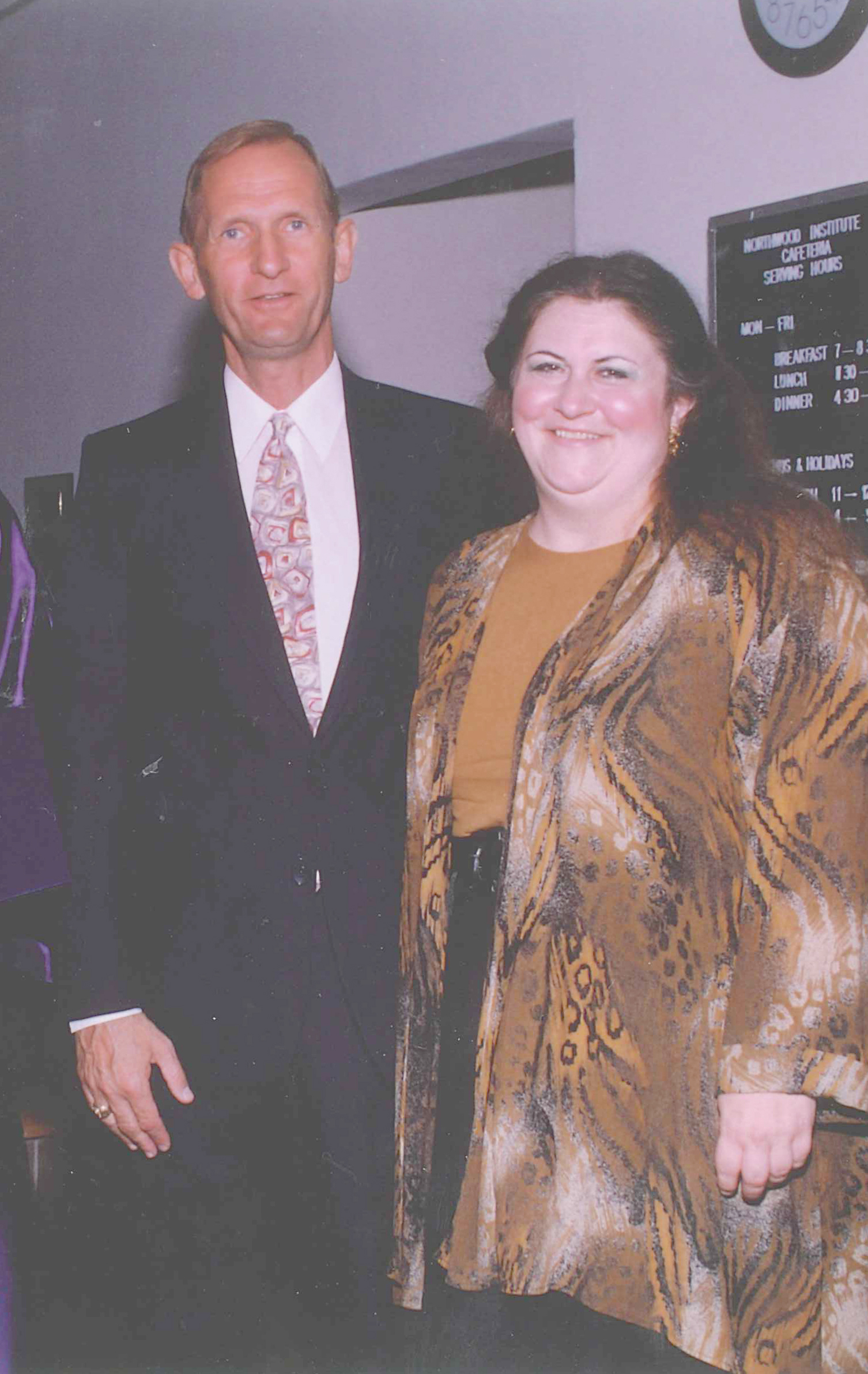 Professors Mike Tuttle and Cheryl Pridgeon enjoy a commencement ceremony in the early 1990's.