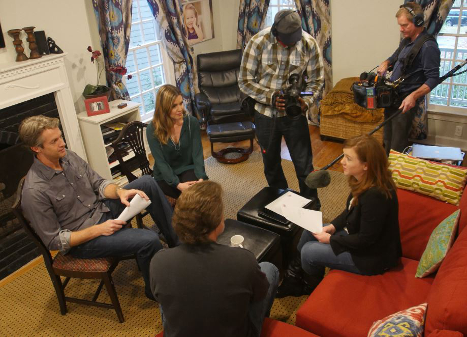 UPtv crew members film as Taepke (right) works with Penn and Kim Holderness (left) on a client pitch.