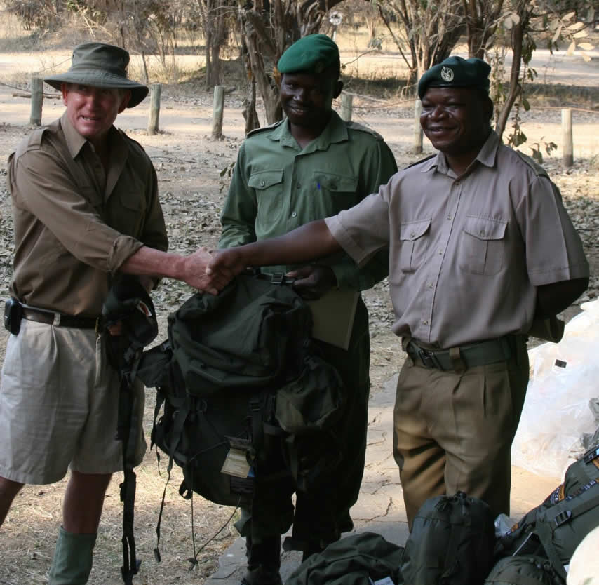 John Stevens of Zambezi Elephant Fund presenting a consignment of backpacks, water bottles, water sacs, cooking sets, sleeping bags to Bright Jeroma, Senior Ranger at Mana Pools, for use by anti-poaching Rangers in Mana Pools National Park.