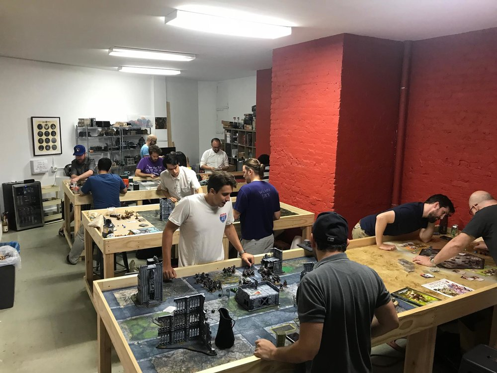 A space in Brooklyn to play... - Space is a premium in NYC! If you enjoy big, chunky tabletop, board, or card games, it can be hard to find a place you can play. We have tables custom built for your gaming needs! Are you a wargamer? We've got tables, mats, and terrain to get your game in! Are you more of a card and/or board gamer? Our library of board games is open to members and a community of card gamers are playing at our space most nights.