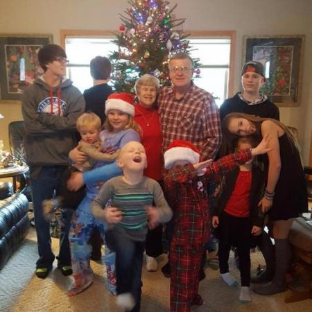 Silly family picture at Christmas with cousins and Grandma and Grandpa
