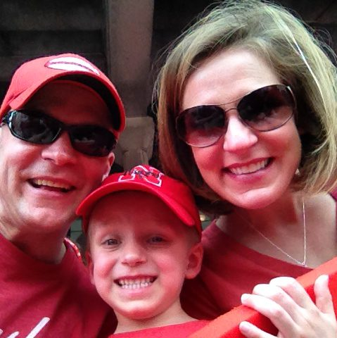 Cheering on the Huskers with Scott's sister and nephew