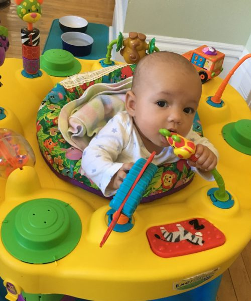 She explores the exciting toys on the Exersaucer