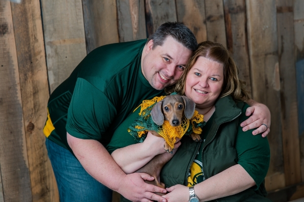 michael, jeri lynn and their dog, millie, love to cheer on the packers!