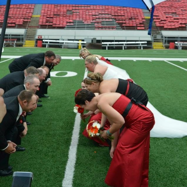 even on our wedding day, we thought about football! Getting our photos done at camp randall in madison.