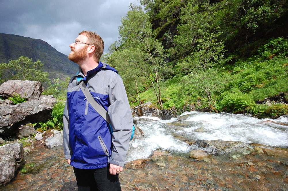 David beside a stream in Glen Coe in the Scottish Highlands -- another stop on our honeymoon adventure. We love to hike in wild places at home and abroad