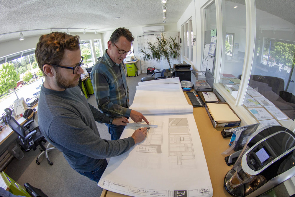Darren and Sean looking over blueprints in office.jpg
