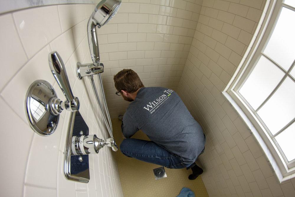 Darren making a shower repair.jpg