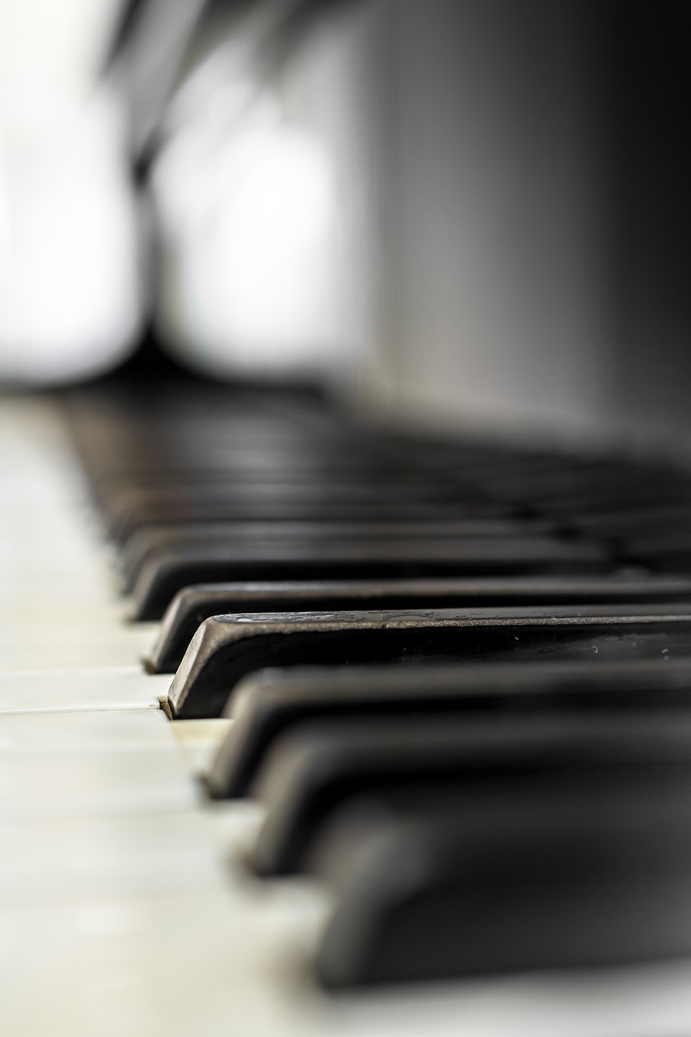 bigstock-Extreme-Close-up-Of-Piano-Keys-232393648.jpg