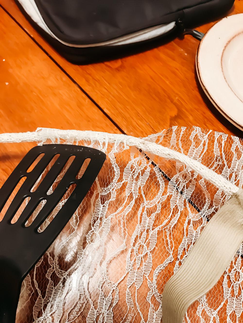 Hot glue the lace. Use a spatula