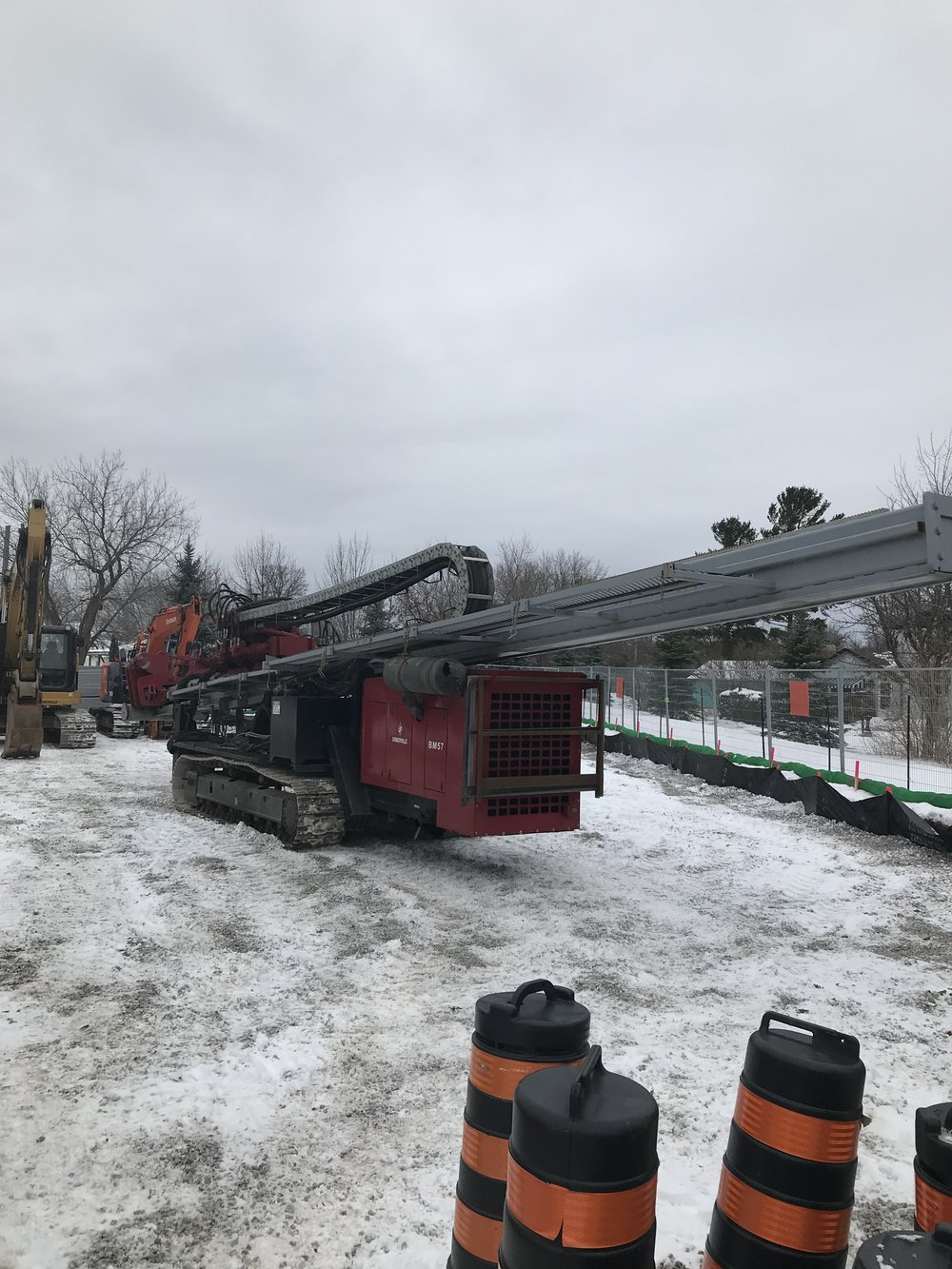 The Horizontal Directional Drill (HDD) being unloaded. The HDD was used to bore a hole that the new natural gas pipeline would be inserted through.