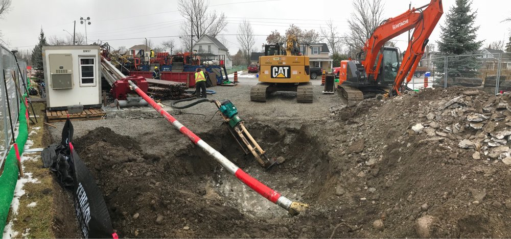 Crews prepare the powerful HDD to bore holes through layers of rock. The new natural gas pipeline was installed beneath the Fenelon River.