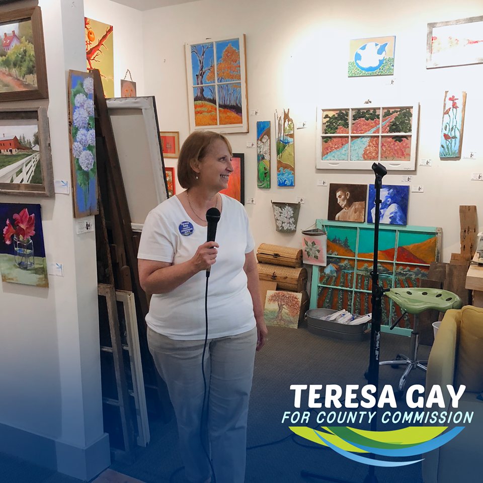 Teresa Gay viewing an art gallery
