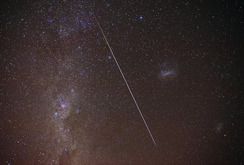 Geminid meteor shower framed between Milky Way and Magellanic Cloud, Photo by Heine Wieben Rasmussen, Bliss & Stars