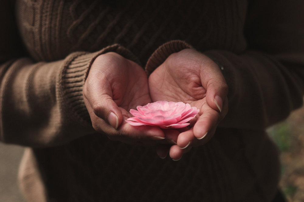 Woman holding gently the flower. Understand your mind with mindfulness-photo-by-ester-marie-doysabas.jpg