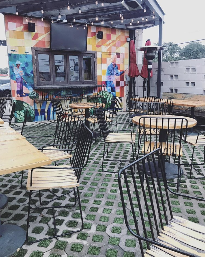 El Bolero - This stunning patio is a perfect blend of color, minimalist seating, and lush greenery. And admit it, you've been meaning to try their famous Oilman black margarita.