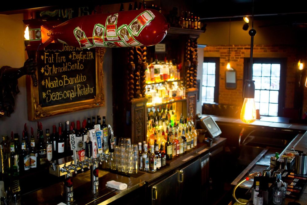 The Quarter Bar | 3301 McKinney Ave. - This New Orleans-inspired spot located next to Breadwinners offers several A+ late night deals.When: Monday: 4 PM to 2 AM; Tuesday: 4 PM to 2 AM; Wednesday: 4 PM to 2 AM; Thursday: 4 PM to 2 AM; Friday 10 PM to 1 AM; Sunday: 4 PM to 2 AM.Bargains: Monday: $1 PBR and 1/2 price pizza; Tuesday: 1/2 price taps and frozens, ½ price apps; Wednesday: 1/2 price select whiskeys, 1/2 price food; Thursday: $2 wells, $2 domestics, $4 select wines, 1/2 price sliders; Friday: $2 wells, $2 domestics, $4 select wines; Sunday: $2 off any Texas brand.