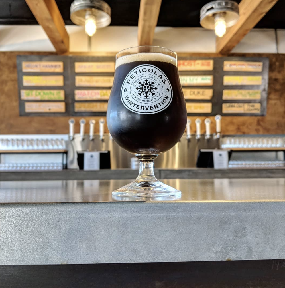 Wintervention | Peticolas Brewing - Has the temperature dropped close to freezing? Then you're in desperate need of a Wintervention. This strong-spiced winter ale checks in at 10% ABV and is as dark as a December night. It's practically another jacket, it's so heavy.