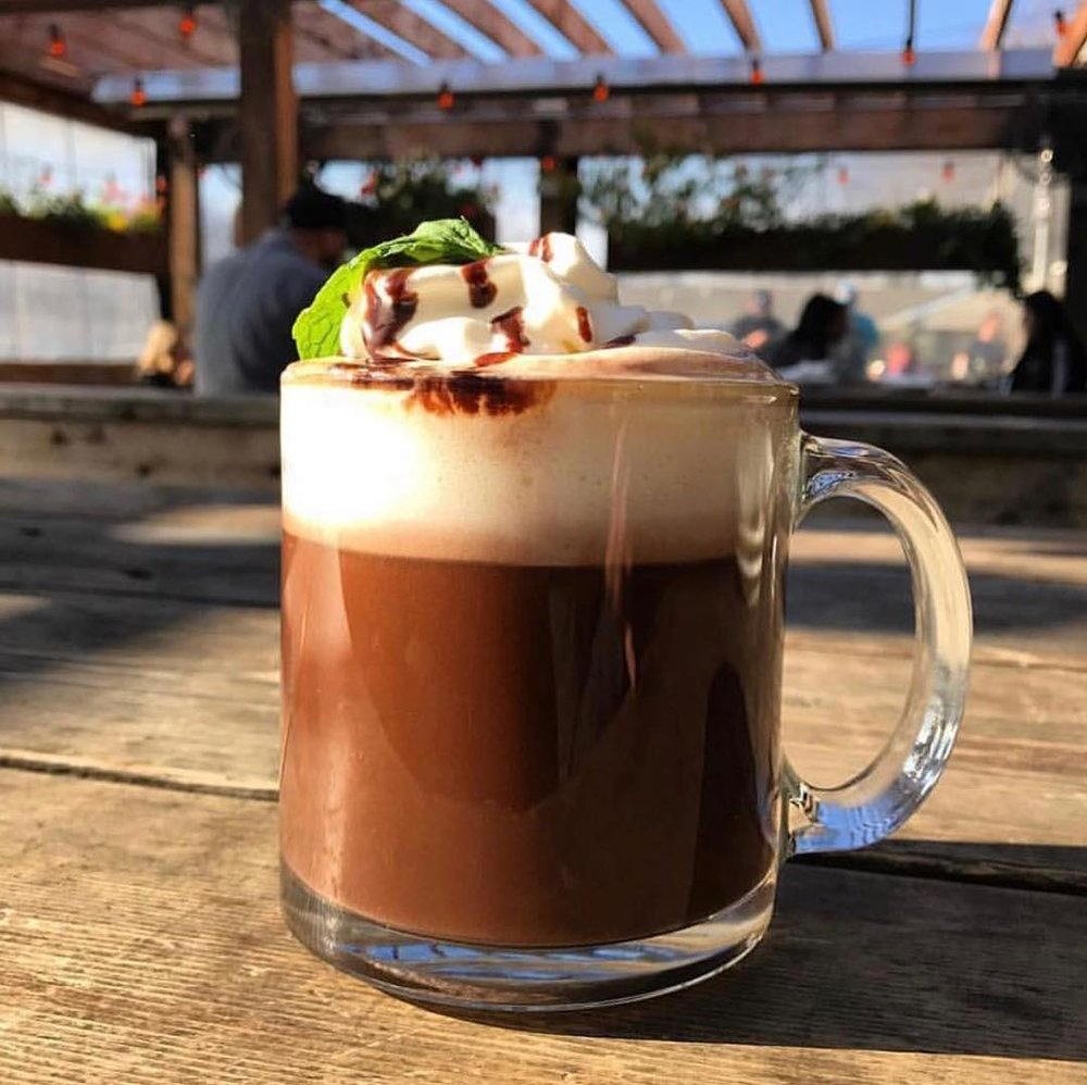 Adult Mint Hot Chocolate at Goodfriend - Don't be fooled by appearances, this simple-looking drink is loaded with Patron XO Café and Rumple Minze. Cozy up to one on their patio or find a corner inside and post up.