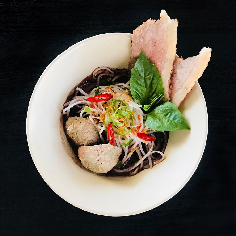 Khao Noodle Shop - What: Say hello to East Dallas' newest noodle spot. On the menu, you'll find dishes like Boat Noodle Soup, a Laotian Khao Soi with fermented soybeans and small bites including tripe chicharrones and fried shrimp bites.Where: 4812 Bryan StreetWhen: Khao Noodle Shop opened on November 20.