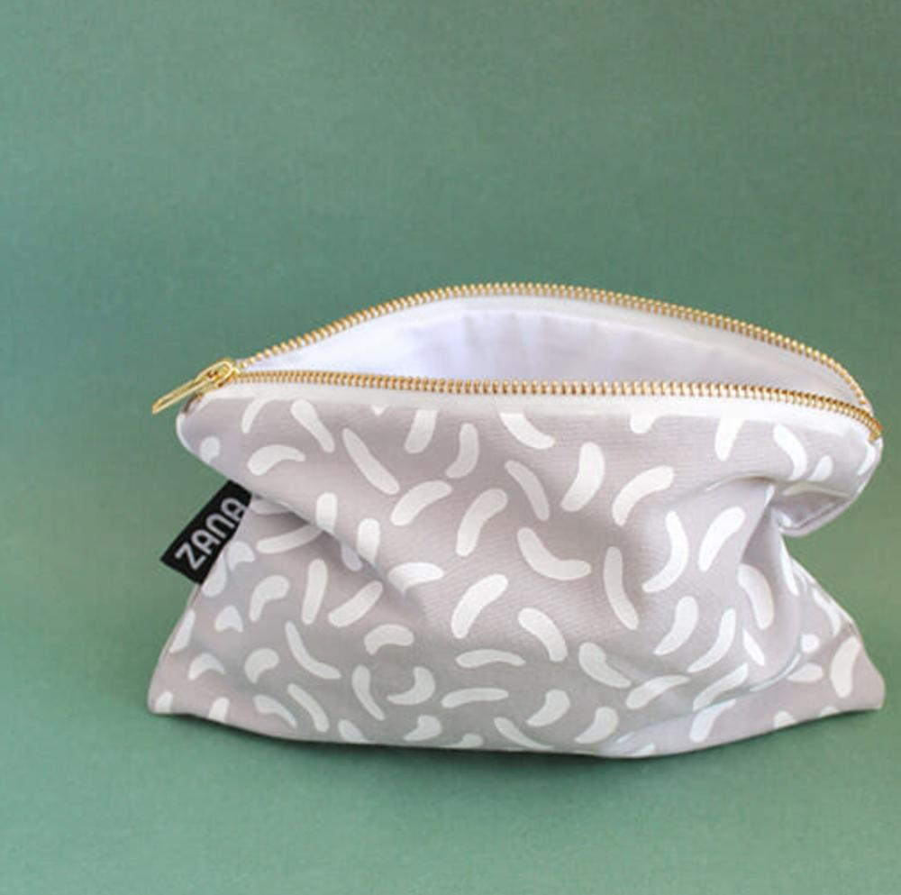 Hey Koneko Confetti Grey Pouch ($15) - This patterned pouch will work for travel, keeping small goods organized, or toting around town as a statement clutch. There are plenty of other patterns also available, so you can scoop up a few for everyone.