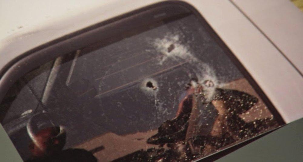 Gunshot hole in window of Brian's truck