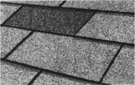 Dark Patches   Where granules have come off the shingle. In addition to affecting the aesthetic of the roof, bore patches like these leave shingles vulnerable to the sun. In time this may dry out the asphalt and lead to leaks.