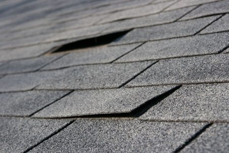 Crooked/Curled Shingles   Are quite often caused by high winds or flying debris and their repair priority is usually a judgement call based on the severity of the damage.