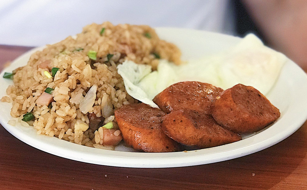 Times Coffee Shop . 2 eggs over-easy, Portuguese sausage, and their signature fried rice.