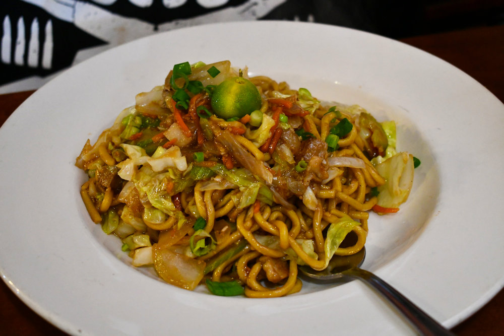 Pancit Miki Guisado . Stir fried thick Chinese-style noodles tossed in a savory sauce with pork and various vegetables.