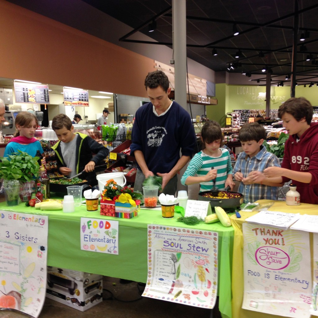3rd and 4th grade students gathered at Sure Save on Sunday 5/31 to do a demonstration of two of the dishes they learned about in the Food Is Elementary program