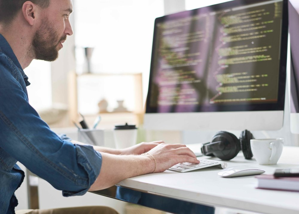 A Marine Software Engineer at work on a computer